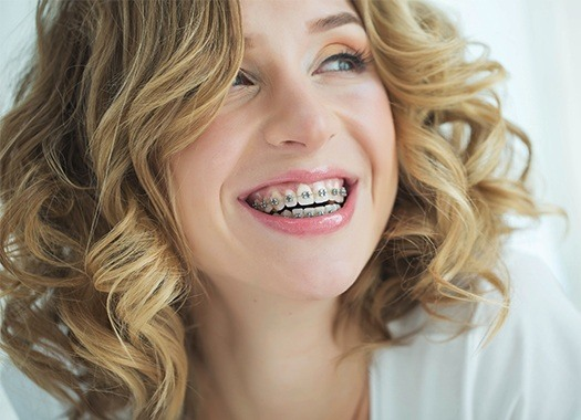 blonde Woman with braces sharing beautiful smile