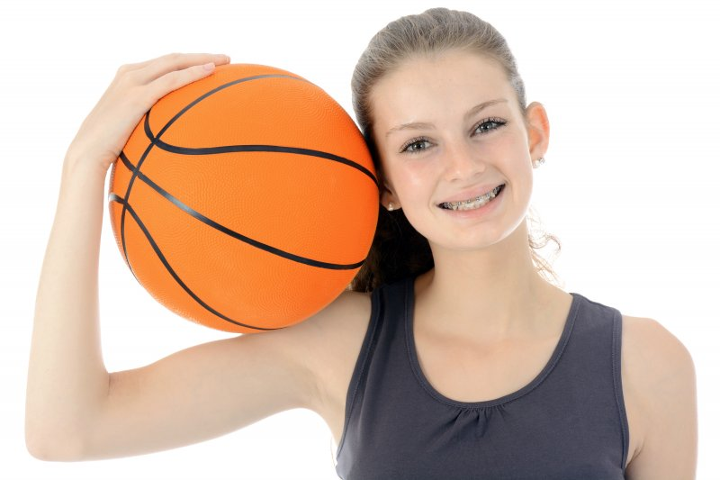 Girl with braces holding basketball
